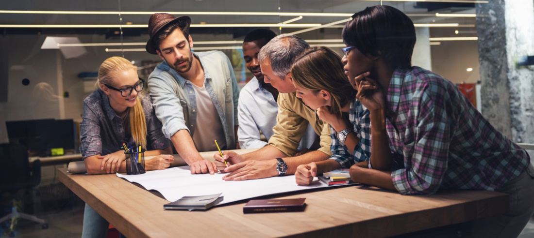 Diverse Engineers around a workspace